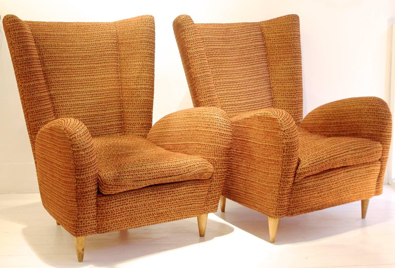 Pair of 1950s Italian armchairs attributed to designer Paolo Buffa, new upholstery using Robert Allen design fabric.