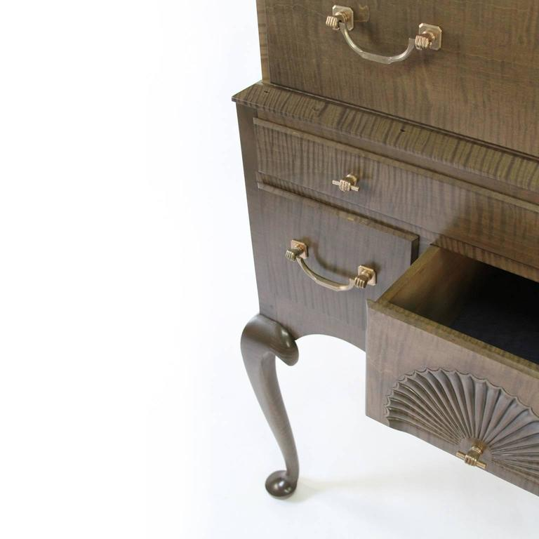 O&G Studio's take on the 18th century Connecticut style highboy. This piece combines a stunning signature stain finish over solid tiger maple. Other details include hand-carved fans and legs, dovetailed drawers and custom O&G bronze fist hardware. A