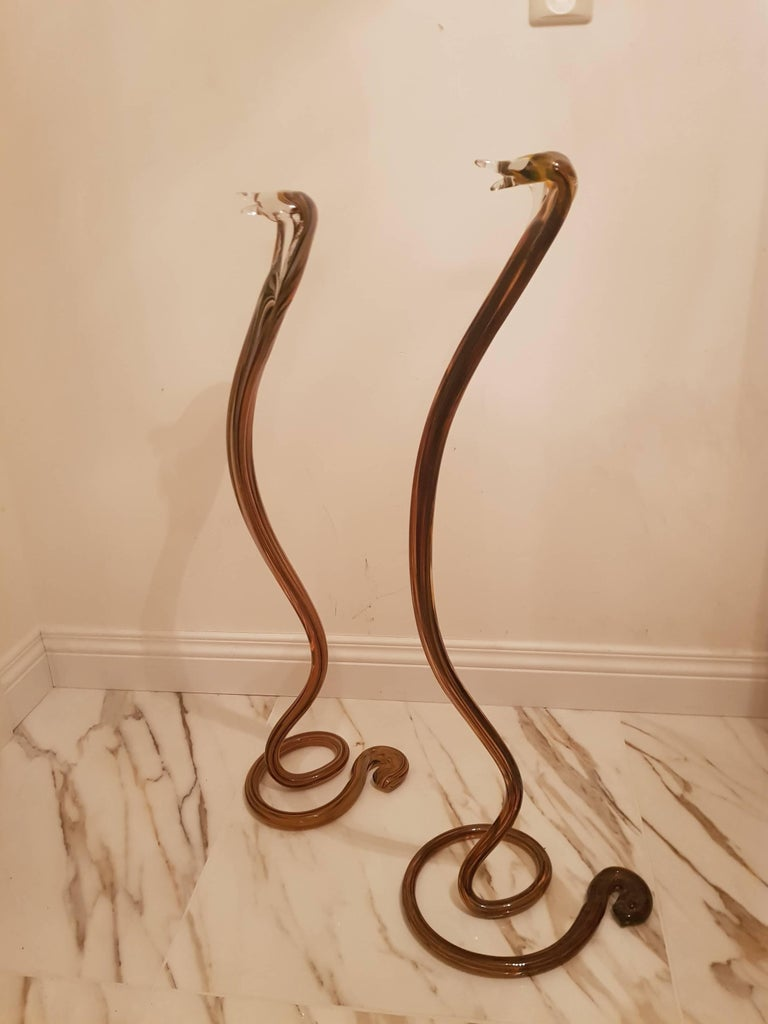 Two Murano cobras handblown and perfectly shaped to a cobra, one slightly bigger but a great pair. Dimensions: 90cm high, 25cm width, 30cm depth. 88cm high, 22cm width, 24cm depth.
