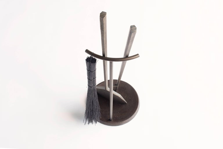 Designed by Borough Furnace  Made by hand in cast silicon bronze, our Hearth Tools have a burnished finish that will naturally patina over time. The Stand, made from blued steel and seasoned cast iron, has a Horween leather pad (scrap from a local