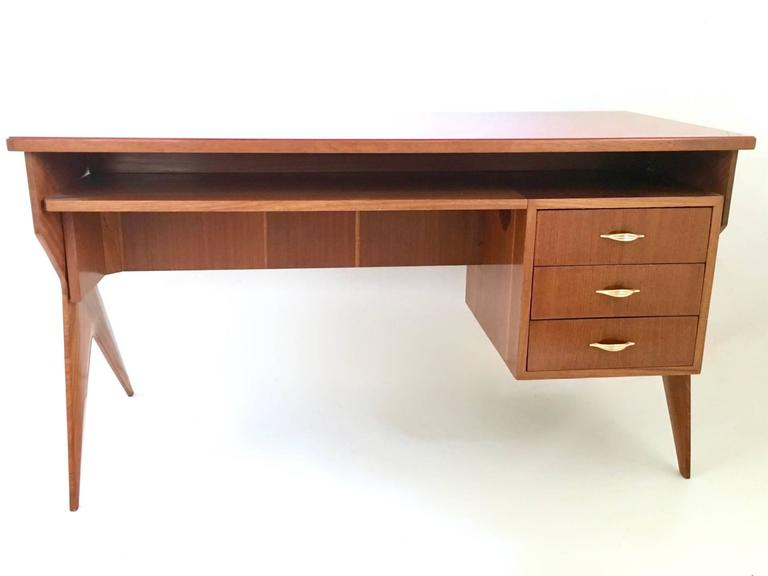 Made in mahogany and features a back-painted glass top and brass parts. It has been restored and polished with shellac. In perfect condition.