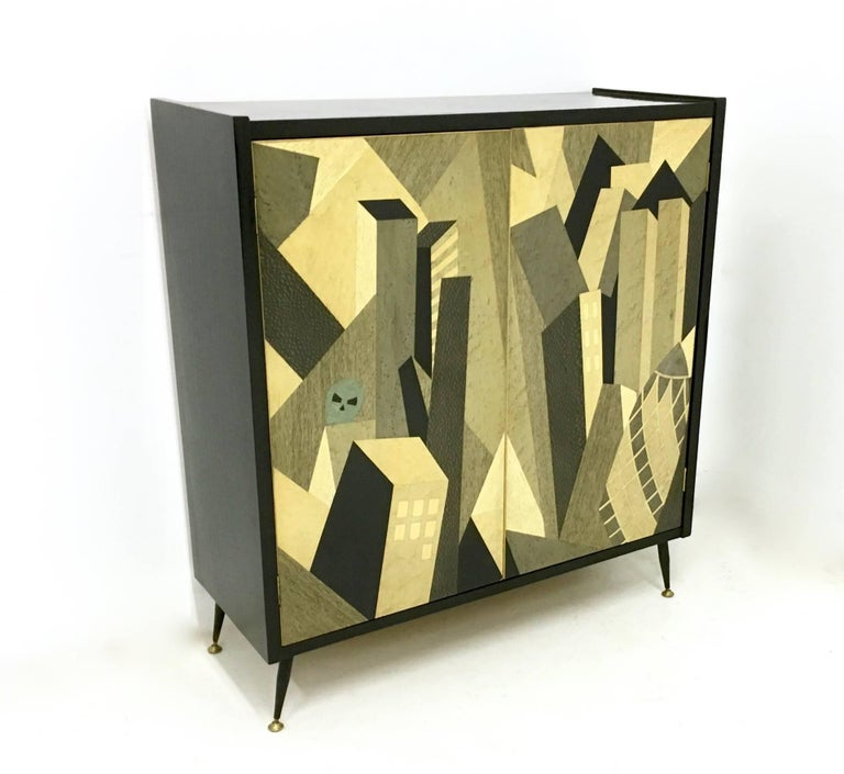 It is designed by Enzio Wenk and handmade.  This stunning cabinet is one-of-a-kind.  It is made with different woods and features crystal shelves.  It is new.  Width: 91.5 cm Depth: 35.5 cm Height: 100.5 cm