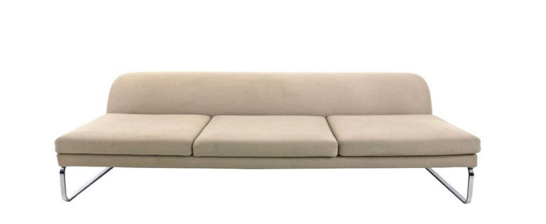It features a very solid metal structure and padding upholstered in fabric by Tacchini. It is in good original condition, but may show traces of use.  Measures:  Width 212 cm Height 60 cm Depth 97 cm.