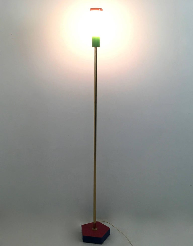 """This floor lamp is made in brass, steel, varnished iron and formica, with an opaline glass lampshade.  In mint condition and signed by the author.  """"Carmelo La Gaipa, an independent author of ideas that are then put into images, has always been"""