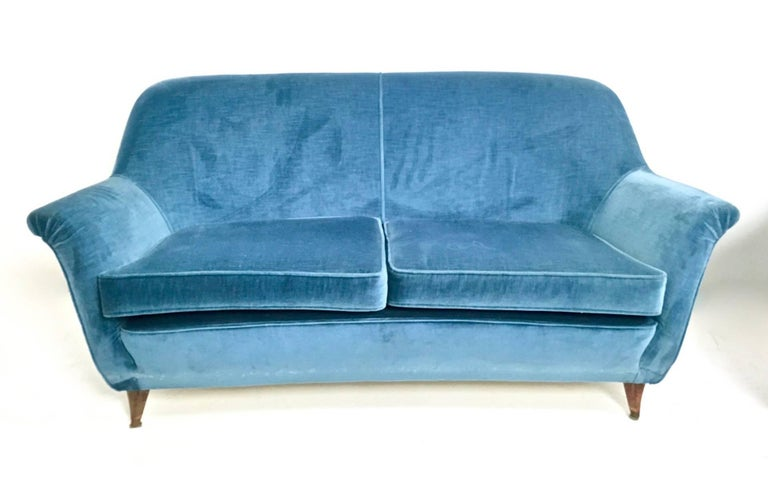 This set features a wooden structure upholstered in vintage velvet. In very good original condition. On request we can sell the set separately.  Armchairs: Width: 78 cm  Depth: 76 cm  Height: 76 cm   Sofa:  Width: 155 cm Depth: 76