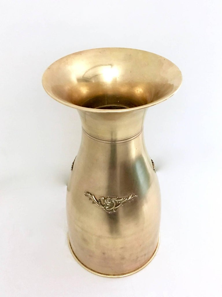 Made in brass. It is in good original condition.