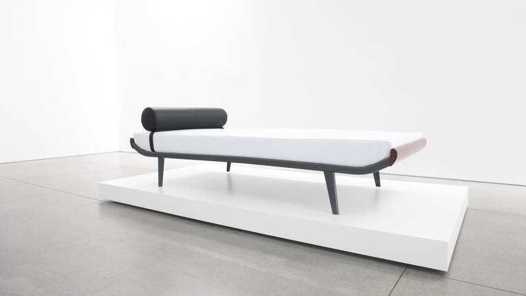 1960s Cleopatra style daybed by A. R. Cordemeier. Teakwood ends with powder-coated black metal frame. New white leather upholstered mattress and black leather bolster.