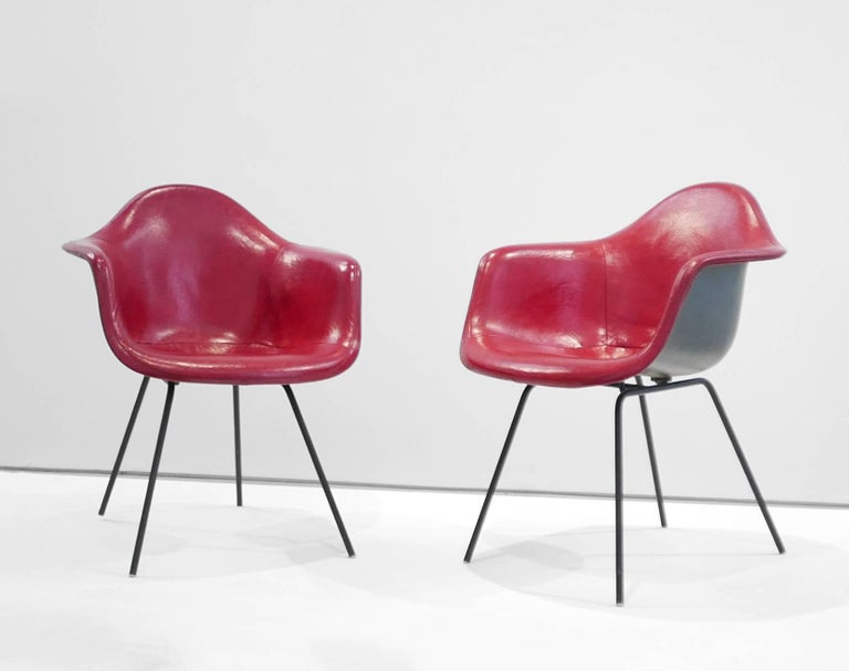 Charles and Ray Eames Pair of 'DAX' chairs  The DAX chairs were designed by Charles and Ray Eames and was manufactured in the United States by Herman Miller in 1955. It is made from fiberglass and features a black enameled steel base. It belongs