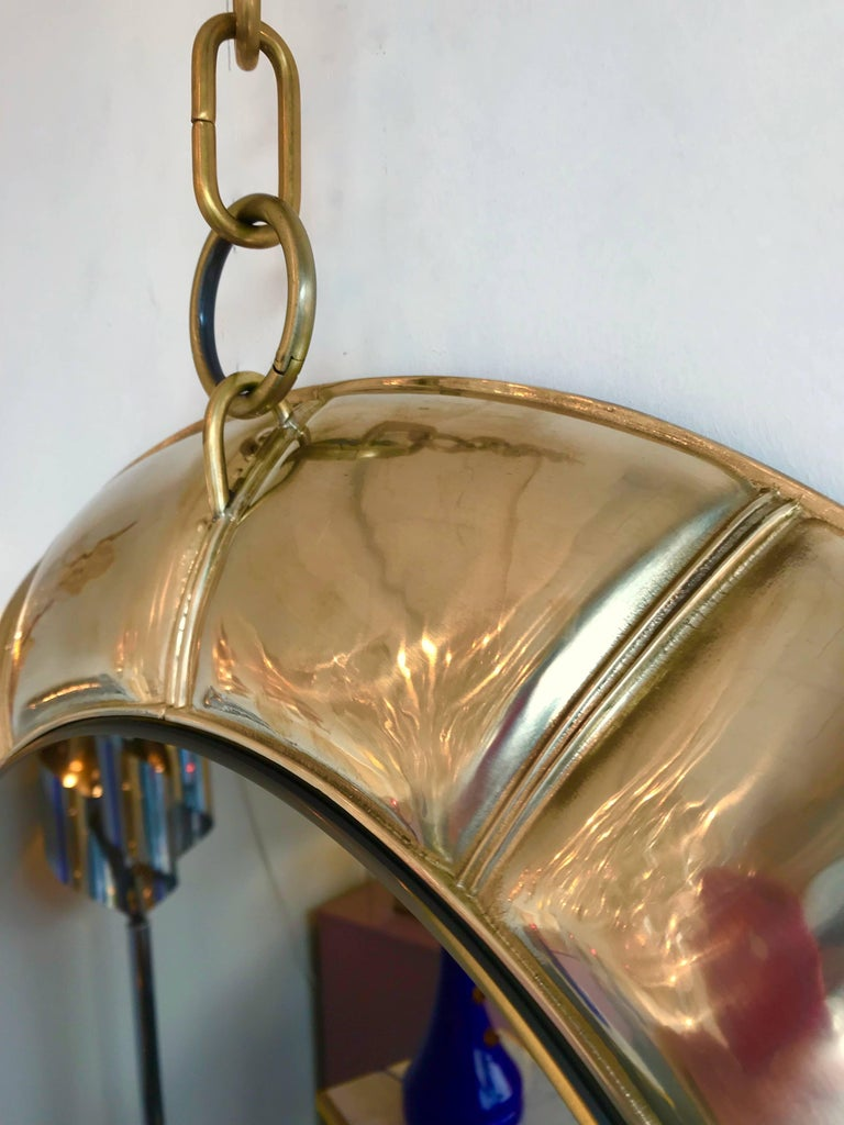 Mirror brass hanging by chain. Limited edition of 10 exemplary.