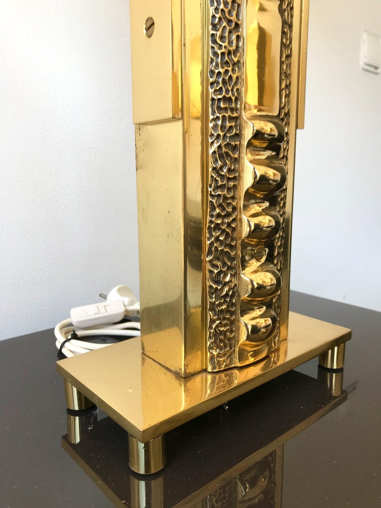 Very rare pair of Brutalist sculpture totem hammered brass lamps by Luciano Frigerio. End of 1970s beginning of 1980s. Important size, very heavy, the great Frigerio work. Sign under the base. Measures: Height body lamps 64cms. Famous design like