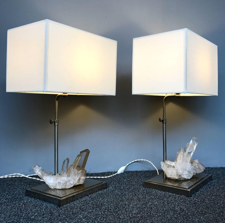 Elegant pair of lamps, nice rock crystal quartz natural stone. Perfect lampshade. Lamps manufacturing typical of the 1970s in a curiosity cabinet spirit. Height adjustable H 60 cms.