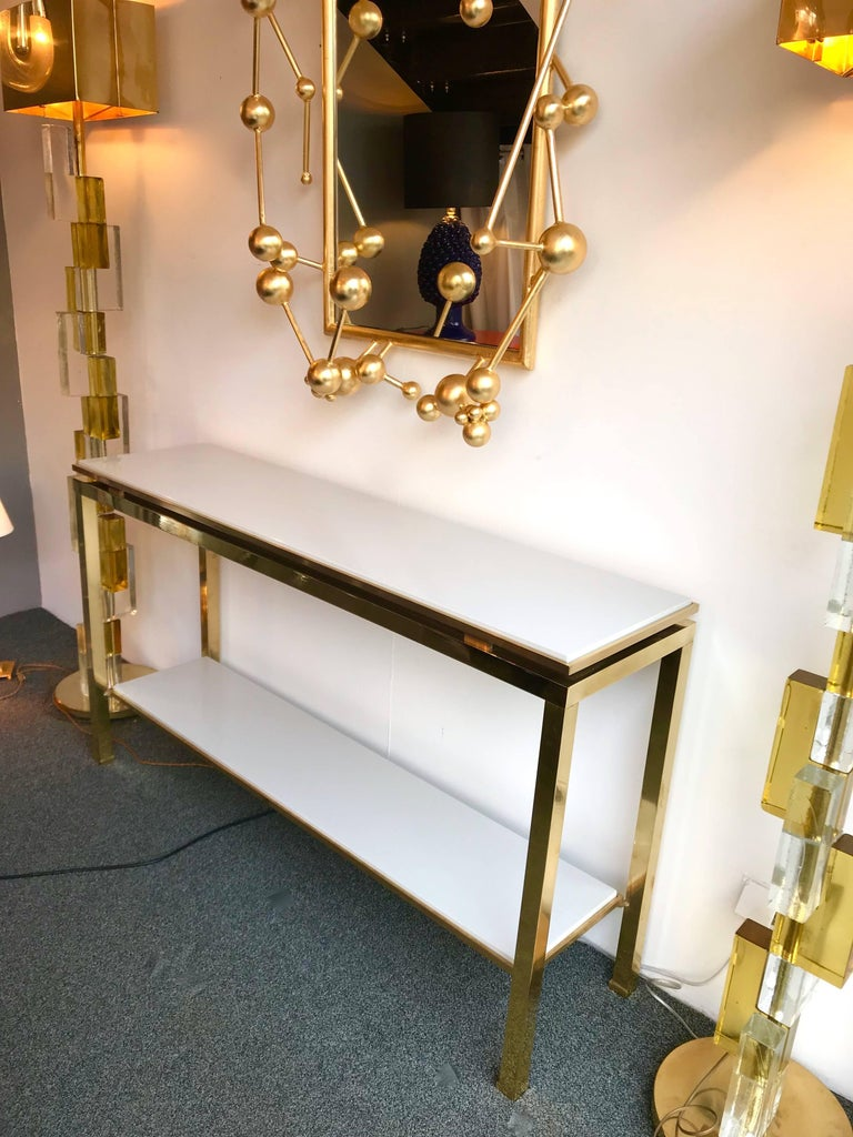 Long model of console table by the designer Guy Lefevre for Maison Jansen, full brass, double light grey lacquered wood top. Famous manufacture like Jean Claude Mahey, Romeo Rega, Bagues, Willy Rizzo, Mario Sabot and Hollywood Regency.