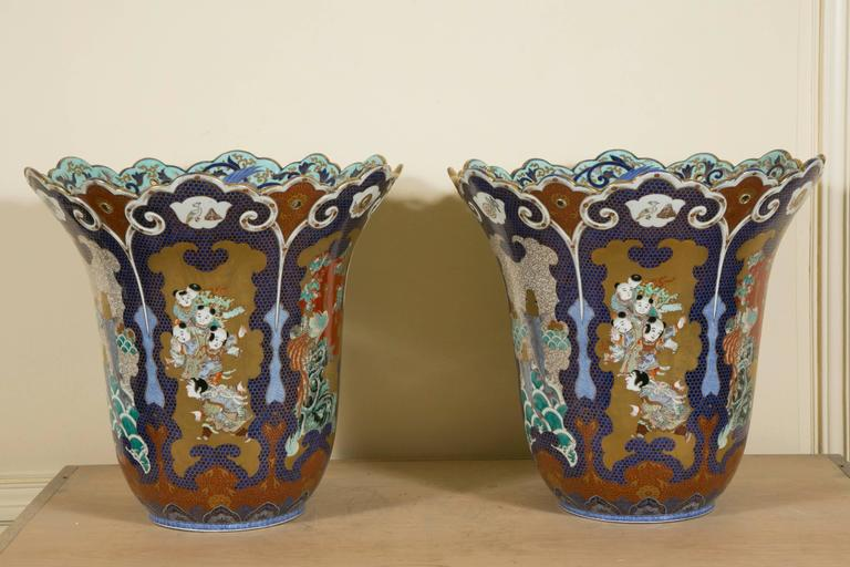 Pair of exceptional 19th century extra-large Palatial Japanese Fukukawa (Imari district) vases of the Meiji period widening upward and indented on top.