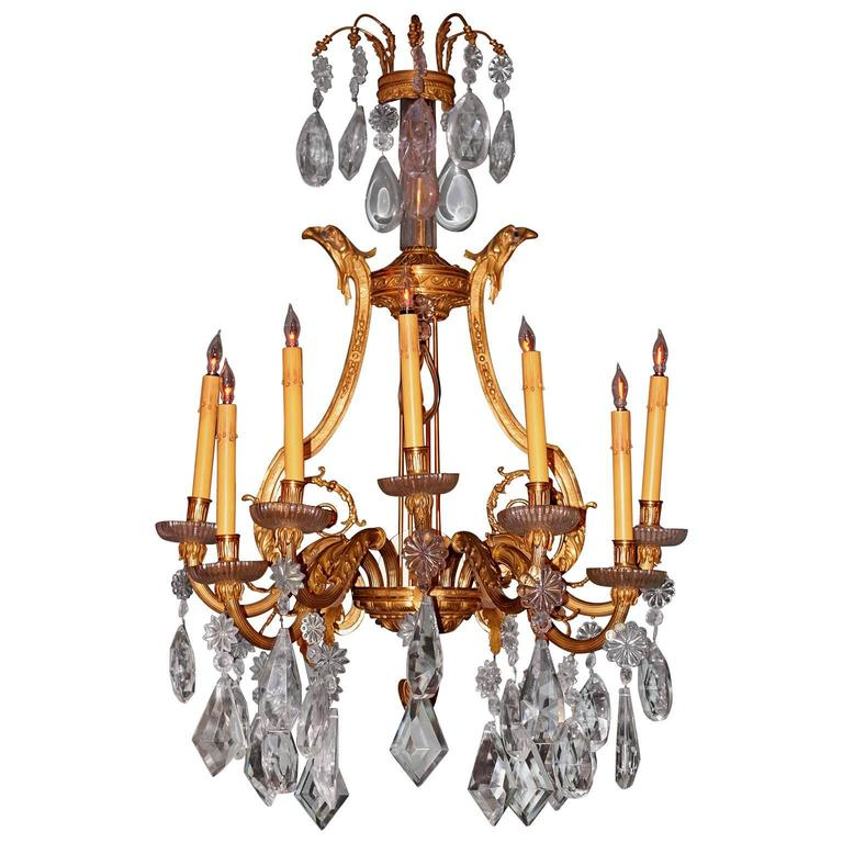 This pair of massive antique French sconce are in great used condition. The ormolu on the bronze combined with extra large cut crystal hanging from the lights makes them exquisite. All the arms are moveable to different directions.