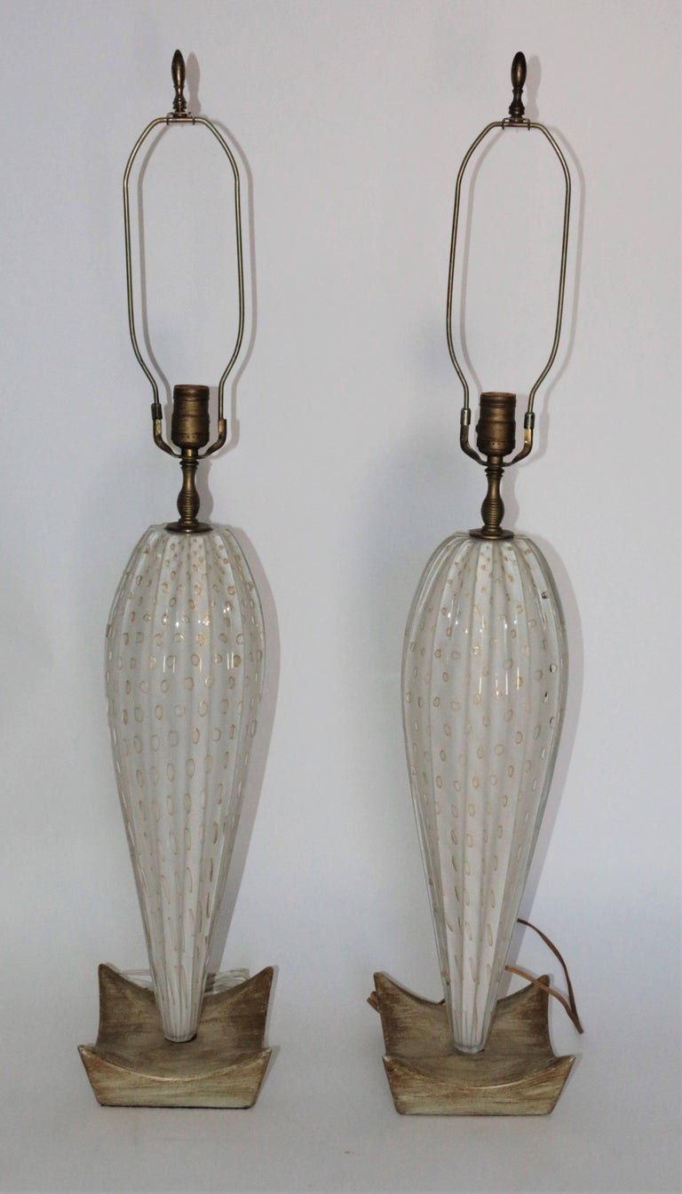 Mid-Century Modern Pair of White Mid-Century Murano Lamps with a Unique Wooden Base and Gold Accent For Sale