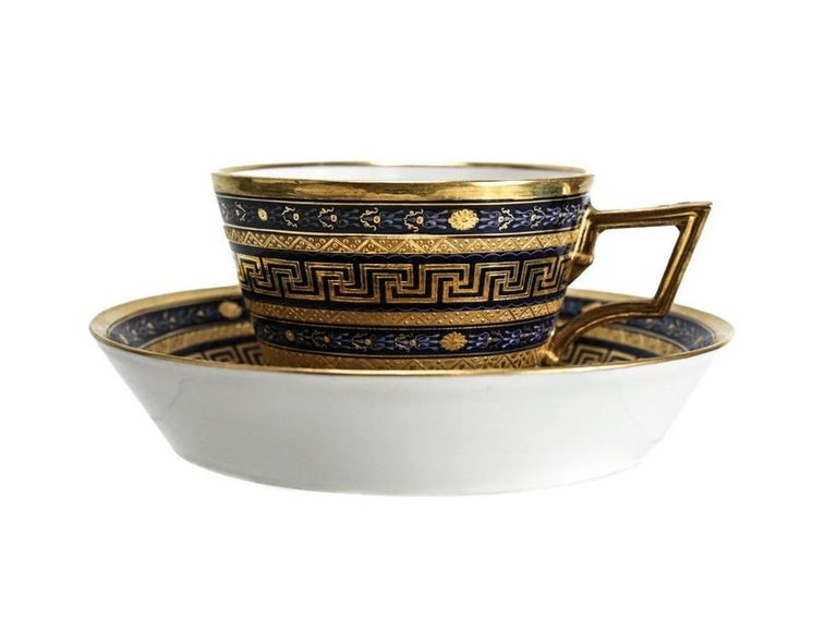 A very fine Vienna cup and saucer from the imperial porcelain Factory in Vienna. The saucer with shape code #39 and the cup with a rare shape code of #12. Both with double Greek Key band pattern in raised gilt, two floral scrolls in light blue