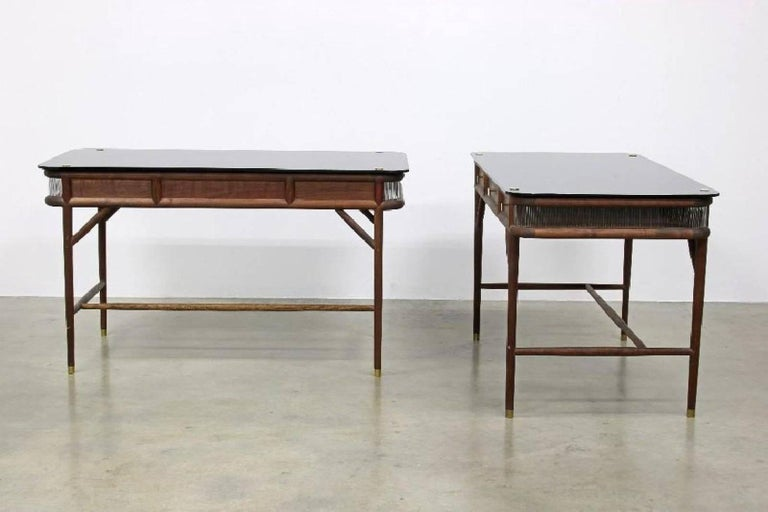 Pair of modern Westin Mitchell 'Parlor' desks. Walnut, polished brass, smoked glass and inlaid glass rods. Measures 55 1/4 L x 28 3/8 D x 31 1/2 H.