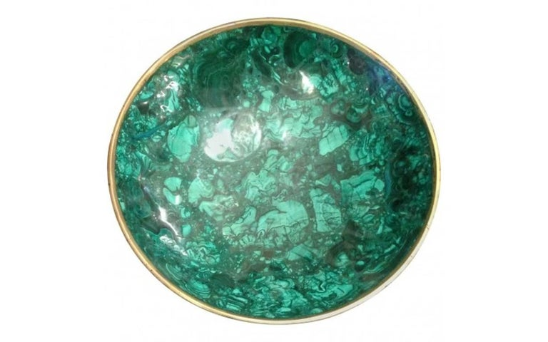 Modern large Malachite sleek and sculptural bowl. This handmade tessellated bowl features a thin bronze rim. Classic forest and emerald green hues give this malachite bowl its eye-catching appearance.  In good vintage condition. Consistent with