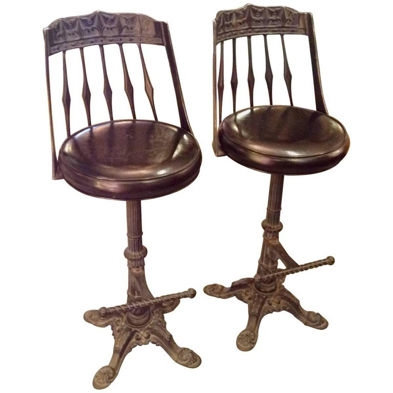 Imbued With An Unmistakable Heirloom Feel These Vintage Bar Stools Have Elaborately Cast Iron Bases
