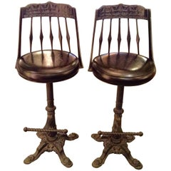 Pair of Cast Iron and Leather Bar Stools