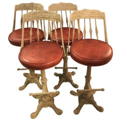 Set of Four Cast Iron Swivel Bar Stools