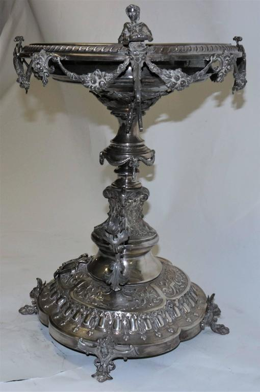 This large and monumental 19th century English centrepiece is bronze covered in silver. The hand done details are finely crafted for an elegant and fabulous look.