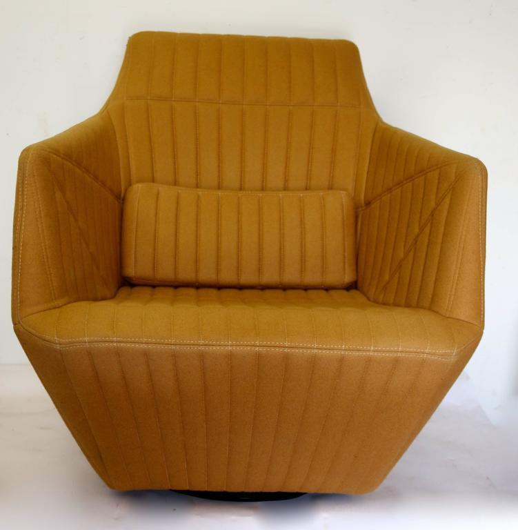 ultra modern ligne roset facett swivel armchair and. Black Bedroom Furniture Sets. Home Design Ideas