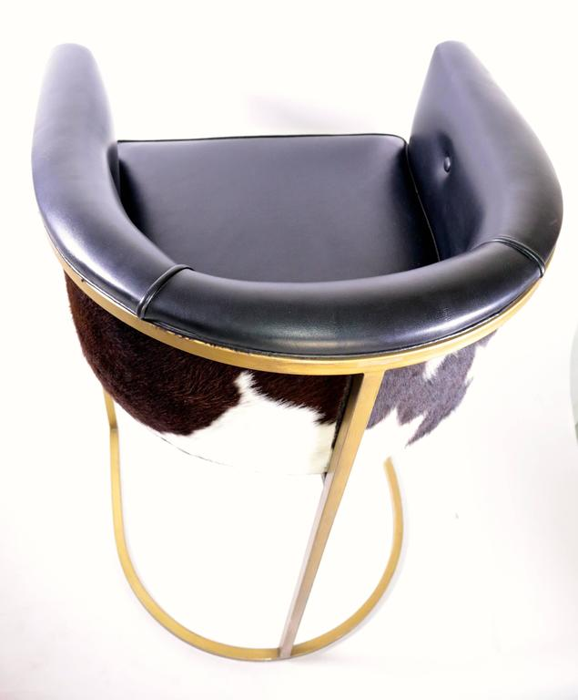 Pair Of Modern Arteriors Calvin Leather And Hide Barstools