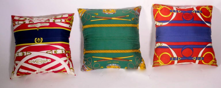 Set of three silk two sided Authentic Hermes pillows. Zipper closure.