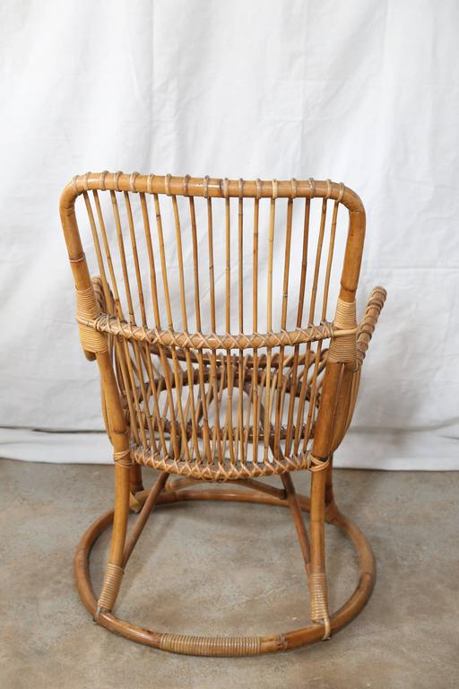 Graceful styling is the hallmark of this pair of rattan chairs from France.