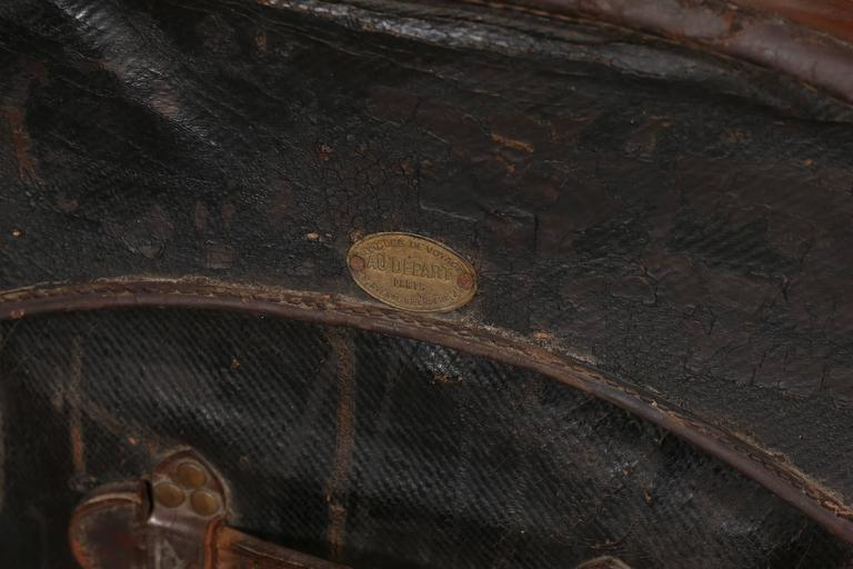 Founded in 1834, Au Depart is considered one of the four greatest French trunk makers. This handsome camel back trunk is superbly constructed of black vulcanized fabric on a woven frame with wood bracings, leather closures and handles attached with