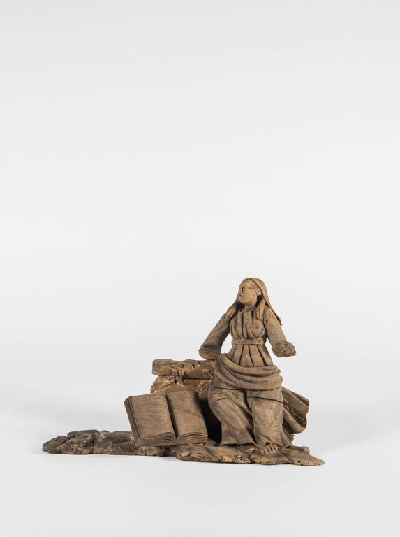 Very old and utterly fascinating, this hand-carved element from France was once part of a larger piece but now this mysterious lady stands alone and keeps her secrets. A lovely example of the carver's art, our lady leans against a vine covered wall