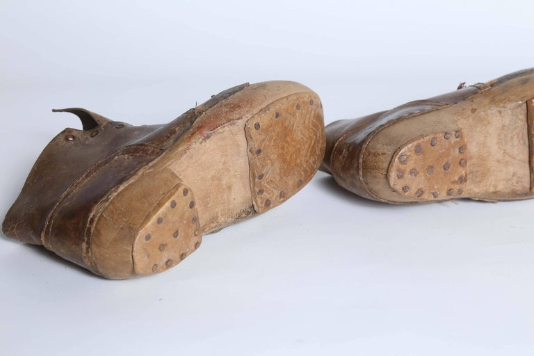 Pair of Old Wooden Shoes In Fair Condition For Sale In Houston, TX