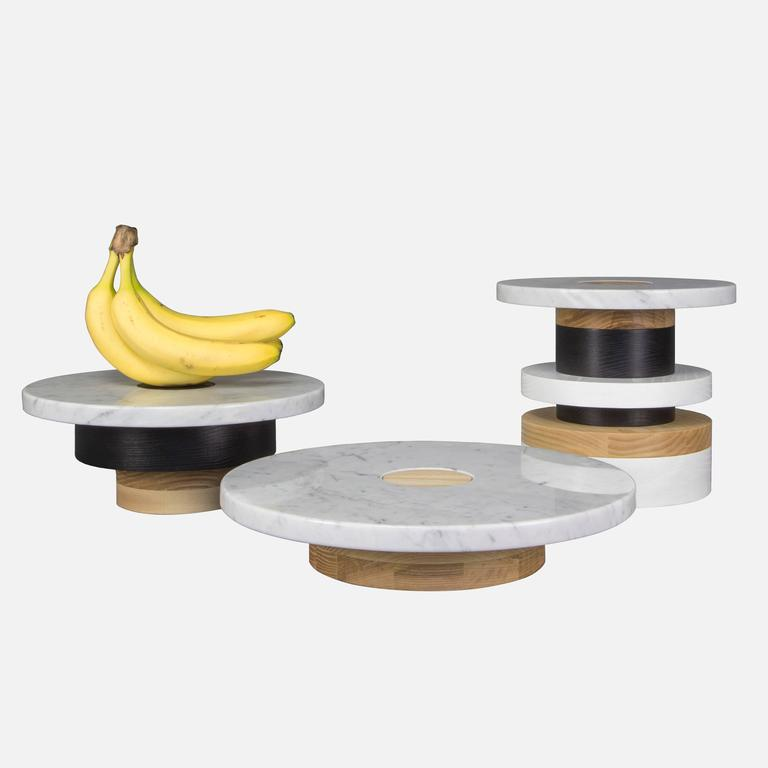 """The Sottsass-inspired """"Sass Pedestals"""" are simple, sculptural accents for your home or retail display. Made from stacked wooden bases and a polished marble top, Sass pedestals are perfect for serving your favourite edible treats, displaying your"""