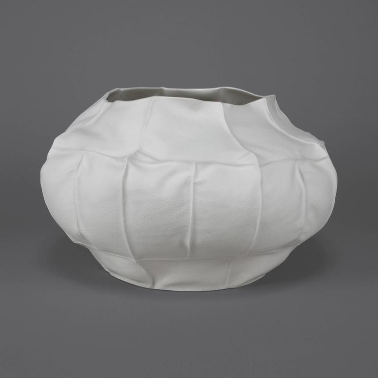 This large limited edition vessel is handcrafted by the designer (and Souda's Co-Owner), Luft Tanaka. Each vessel is made to order with a process that involves casting liquid porcelain into a mold that's made entirely of leather. This highly-unique