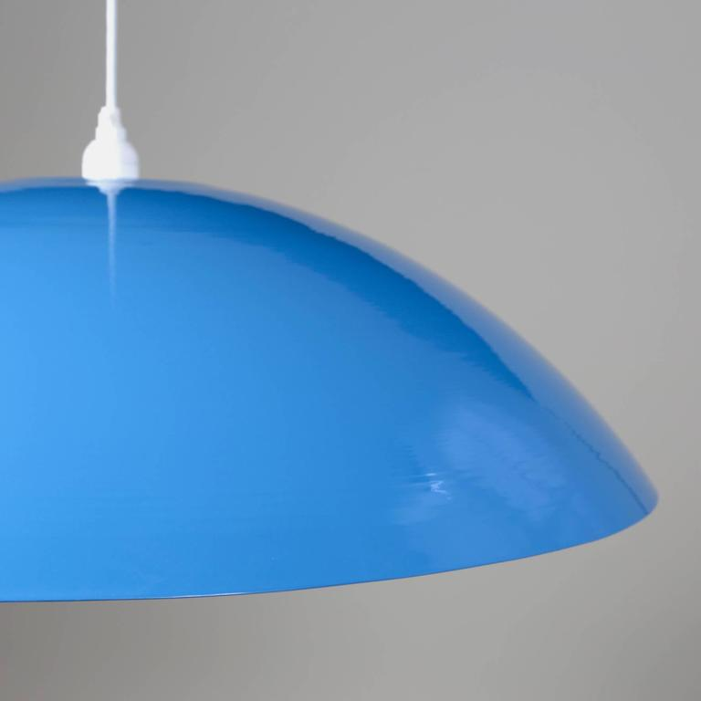This listing is for a custom light fixture that Souda completed for a startup-company's office in NYC. Shown in this image shows the pendant with a light blue finish.  The lights are huge and are a great statement piece. Made in the USA. Measures: