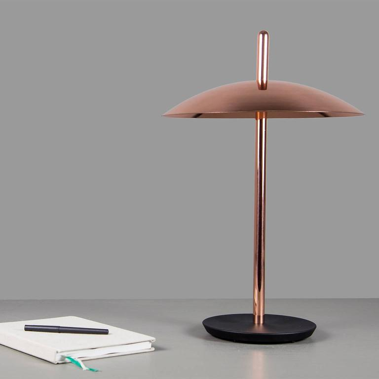 The signal table lamp is familiar, yet futuristic. From beneath it's spun metal shade LEDs cast a warm and inviting glow onto a polished central stem grounded by a cast iron base. With it's refined form and multiple finish options the Signal table