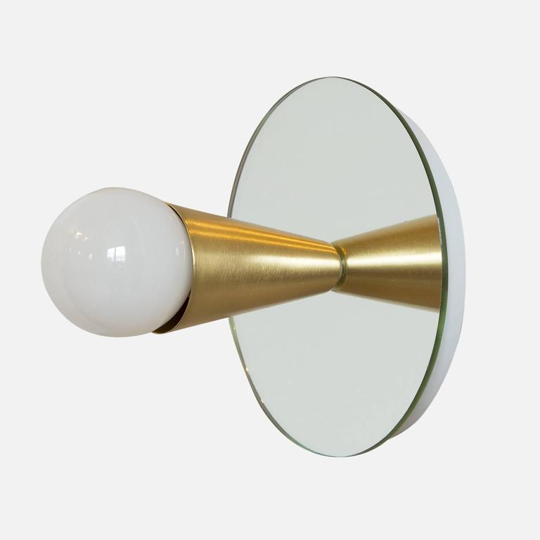 Simple, elegant, and playful, the Echo series is a line of surface-mount fixtures that can be used on a wall or ceiling. White or brass cones mount to mirrored glass to perfectly reflect each bulb, giving the illusion of lights floating in
