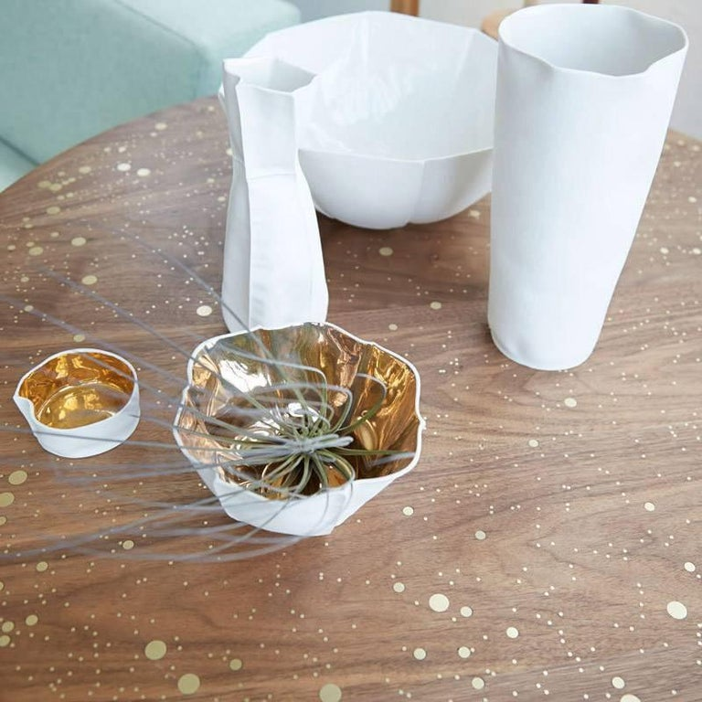 This listing is for a Kawa Dish with a gold glaze. The glaze on this dish contains actual gold and it's made by hand in Brooklyn by the designer (and Souda's Co-Owner), Luft Tanaka. Each dish is made by casting liquid porcelain into a mold that's