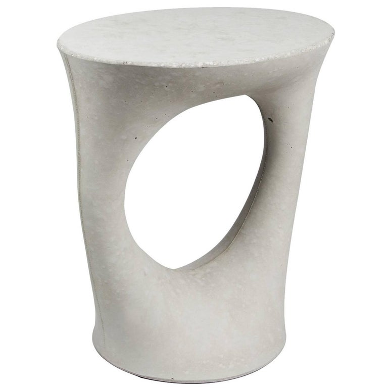 This listing is for a two tables in a light grey finish.   Industrial, organic and sculptural, the Kreten side tables are concrete furniture like you haven't seen before. Original pieces are created in Souda's Brooklyn studio by casting concrete
