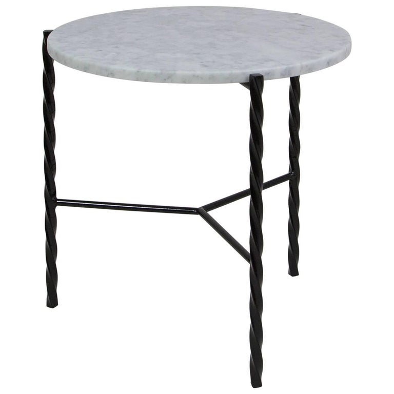 This listing is for two von iron side tables with carrara marble tops.