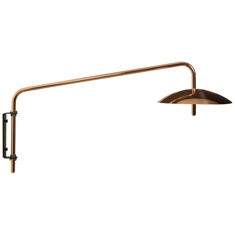 The signal arm sconce is a rotatable sconce that seamlessly blend the Mid-Century Modern aesthetic with that of science fiction. A bent aluminum tube cantilevers from a wall-mounted bracket to allow the spun shade to hover above any interior. Clean,