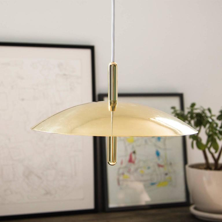 Utilizing warm LEDs and indirect light, signal pendants hover above any interior like a celestial body emitting a comforting glow. Consisting of a spun metal shade pierced by a polished central stem, the signal pendant is minimal and expressive.