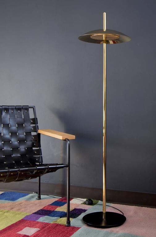 A clear distillation of line weight, the Signal Floor Lamp stands effortlessly in virtually any setting. From a cast iron base a polished stem rises to intersect its spun aluminum shade which houses warm LEDs. Both modern and minimal, the Signal