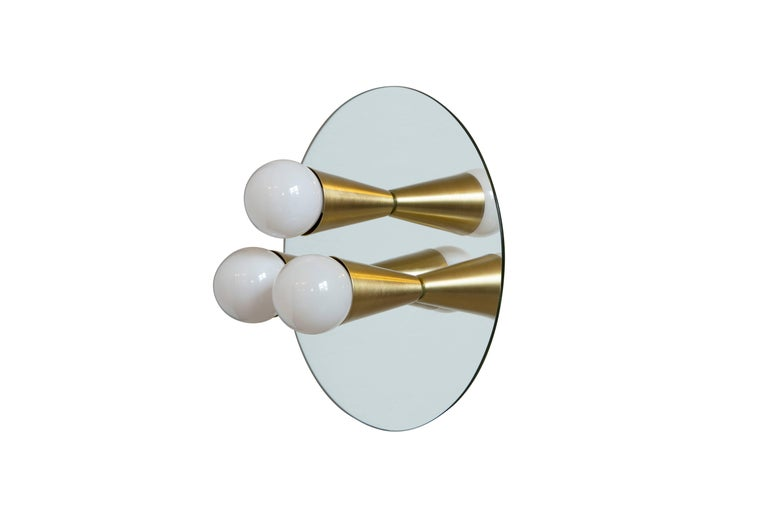 This listing is for a pair of the Echo three sconces. The price includes two lights.  Simple, elegant and playful, the Echo Series is a line of surface-mount fixtures that can be used on a wall or ceiling. White or brass cones mount to mirrored