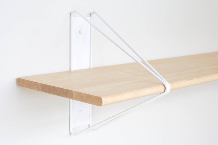 Modern minimalism meets Classic architectural construction in the strut shelving system. Inspired by the Manhattan Bridge and construction techniques of early aircraft, the modular system is functional and flexible making it ideal for commercial and