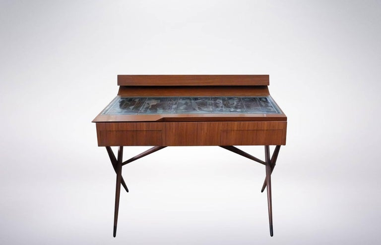 Dresser with open-top stowaway, designed by Ico & Luisa Parisi for Altamira in 1942.  The table-top was realized in enameled copper by Paolo de Poli based on the designs of Pietro Zuffi.  The top opens to expose storage space, and was decorated with