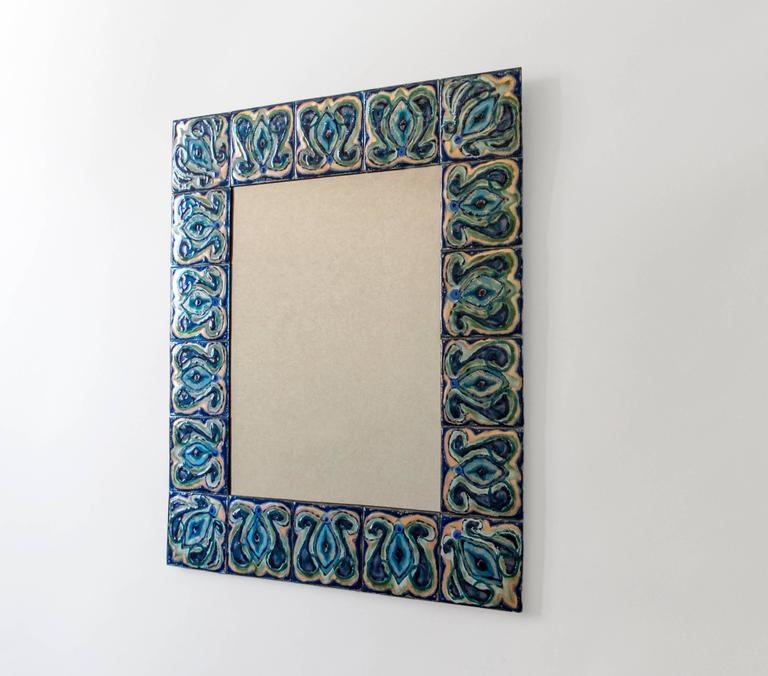 Composed of enameled plates hand-painted by Danish artist Bodil Eje. The repeating pattern displays richly variegated cobalt blue, evergreen, seafoam green, and colorless enamel exposing the copper undersurface, surrounding a colorless rectangular