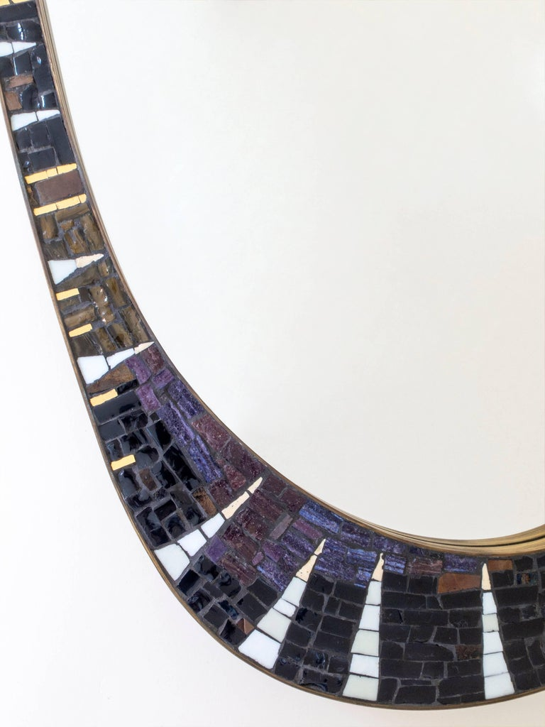 A rare find by artist Berthold Müller-Oerlinghausen, best known as a sculptor and creator of stylish mosaic top tables.   The asymmetric mosaic, composed of intricately laid colored and gilt glass tiles against a graphite colored ground, within a