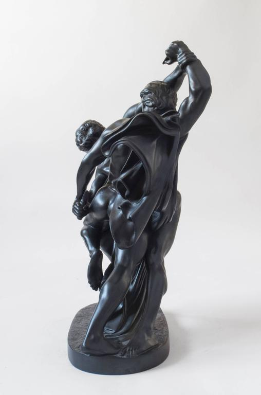 A scaled and beautifully detailed replica of Swedish sculptor Johan Peter Molin's famous bronze depicting fighters engaged in a duel, bound at the waist by a belt. The dark stoneware and glaze beautifully accentuate the finely executed details.